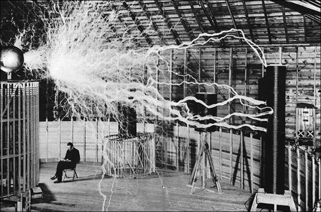 Nikola Tesla in his laboratory.
